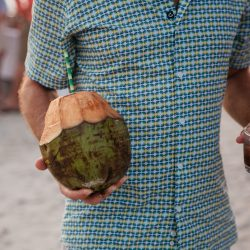 Man Holding Coconut