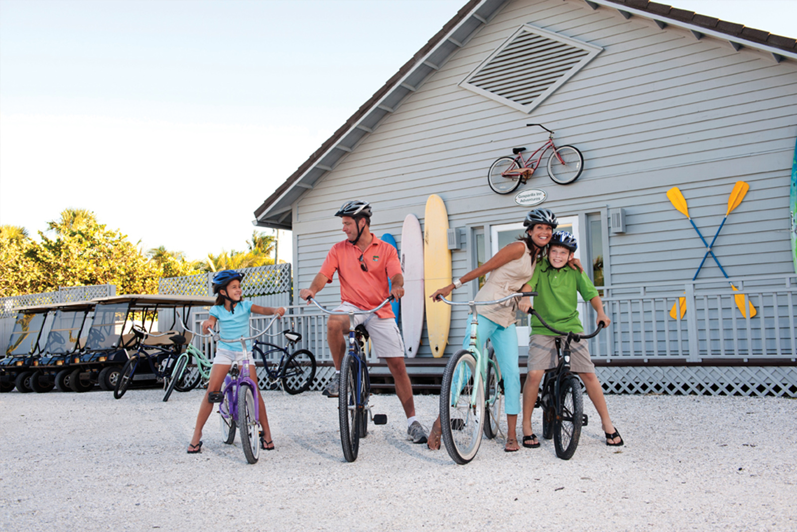 A family posing on bicycles
