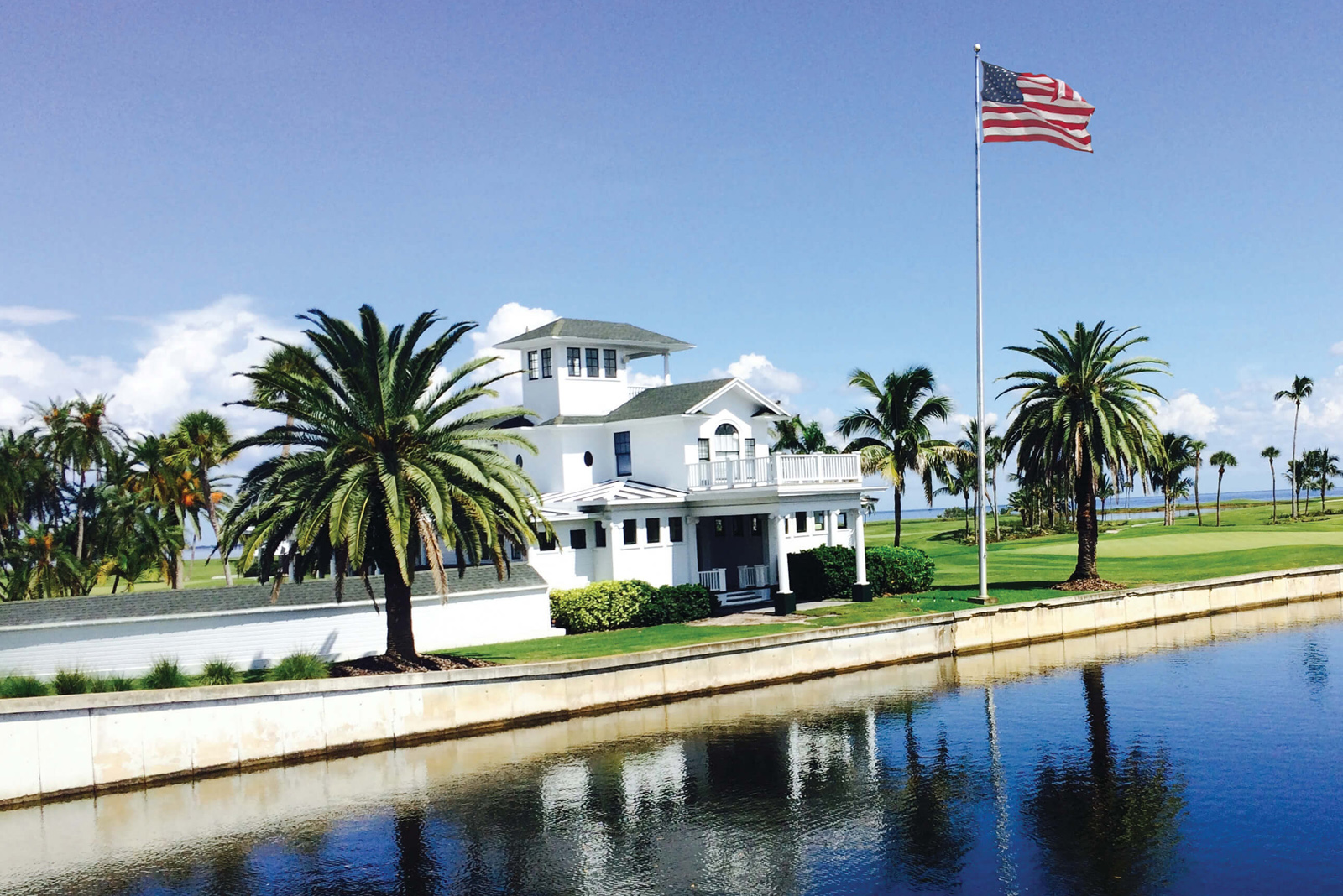 Outside shot of a building on the golf course with an American flag flying
