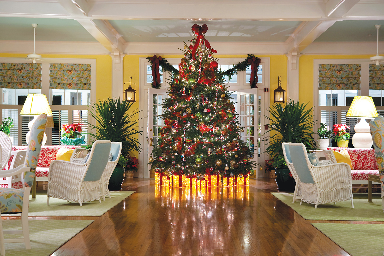 Large lit-up decorated Christmas Tree in a sitting room